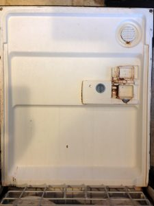 Inside of a dishwasher dealing with hard water